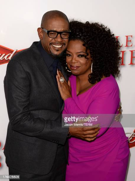 """Actor Forest Whitaker and TV Personality Oprah Winfrey arrive at the premiere of The Weinstein Company's """"Lee Daniels' The Butler"""" at Regal Cinemas..."""