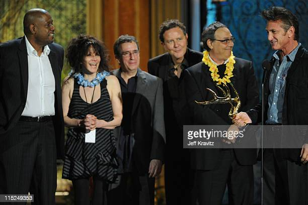 Actor Forest Whitaker director Amy Heckerling and actors Brian Backer Judge Reinhold Robert Romanus and Sean Penn accept an award onstage during...