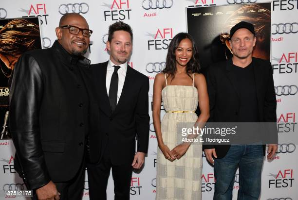 Actor Forest Whitaker director Scott Cooper actress Zoe Saldana and actor Woody Harrelson and Forest Whitaker attend the screening of Out of the...