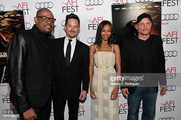Actor Forest Whitaker director Scott Cooper actress Zoe Saldana and actor Woody Harrelson attend the screening of Out of the Furnace during AFI FEST...