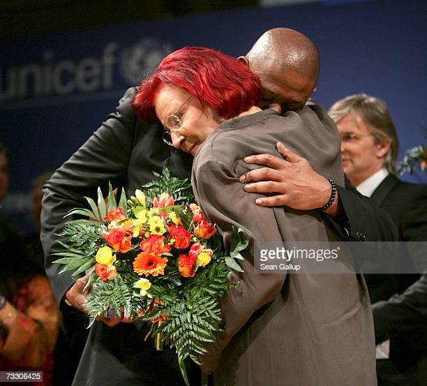 Actor Forest Whitaker embraces German Development Minister Heidemarie Wieczorek-Zeul after he received an award at the Cinema for Peace Charity Gala...