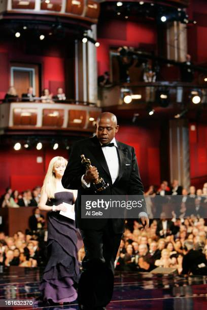 Actor Forest Whitaker is photographed after winning the Oscar for Best Actor in 'The Last Kind of Scotland' with actress Reese Witherspoon at the...