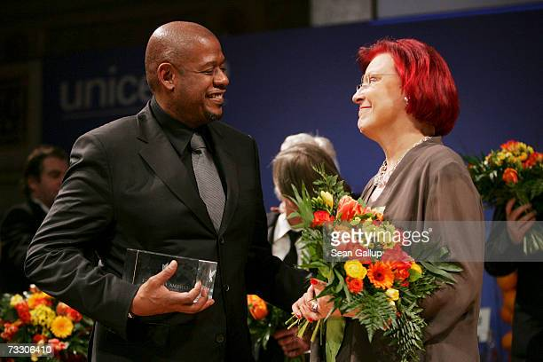 Actor Forest Whitaker talks with German Development Minister Heidemarie Wieczorek-Zeul after he received an award at the Cinema for Peace Charity...