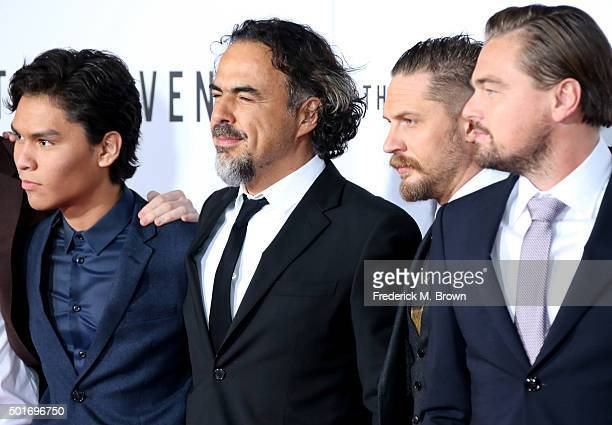 Actor Forrest Goodluck filmmaker Alejandro Gonzalez Inarritu and actors Tom Hardy and Leonardo DiCaprio attend the premiere of 20th Century Fox and...