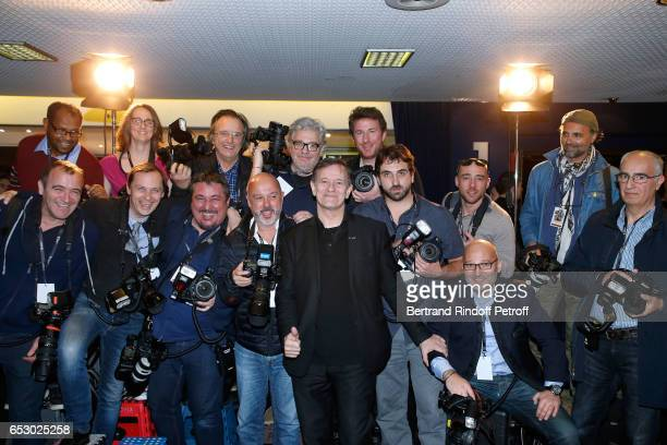 Actor Francis Huster poses with Photographers before the 'Chacun sa vie' Paris Premiere at Cinema UGC Normandie on March 13 2017 in Paris France