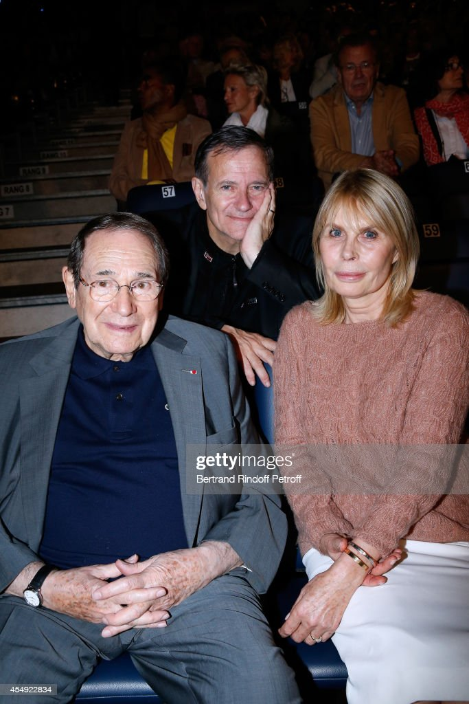 Actor Francis Huster standing between Director Robert Hossein and his wife Candice Patou attend the 'Claude Lelouch en Musique ! Held at the Invalides in Paris on September 6, 2014 in Paris, France.