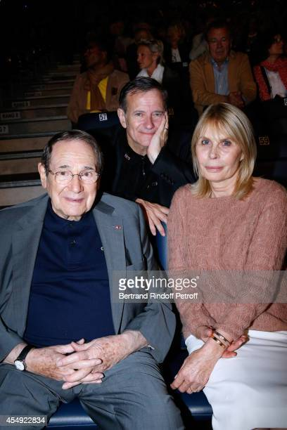 Actor Francis Huster standing between Director Robert Hossein and his wife Candice Patou attend the 'Claude Lelouch en Musique Held at the Invalides...
