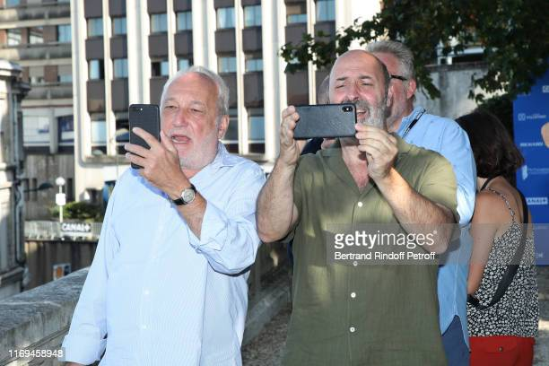 Actor Francois Berleand and Director Cedric Klapisch take pictures during the Photocall of the movie Deux moi during the 12th Angouleme...
