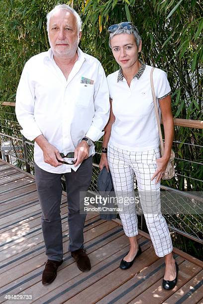 Actor Francois Berleand with his wife Alexia Stresi attend the Roland Garros French Tennis Open 2014 Day 7 on May 31 2014 in Paris France
