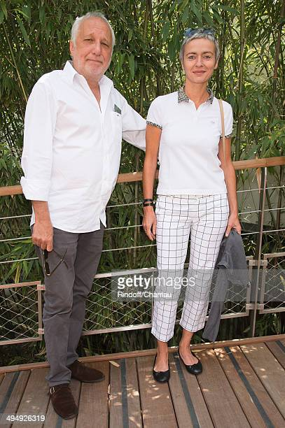 Actor Francois Berleand with his wife Alexia Stresi attend the Roland Garros French Tennis Open 2014 Day 7 at Roland Garros on May 31 2014 in Paris...