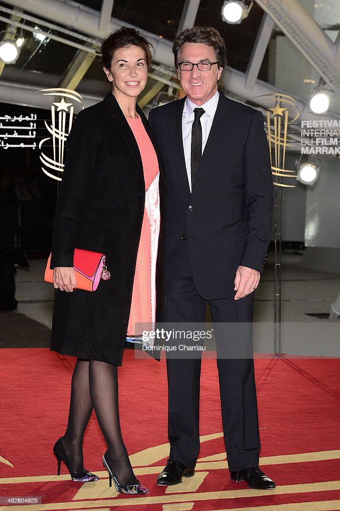 Actor Francois Cluzet and his wife Narjiss attend the 'Like Father, Like Son' premiere during the 13th Marrakech International Film Festival on December 1, 2013 in Marrakech, Morocco.