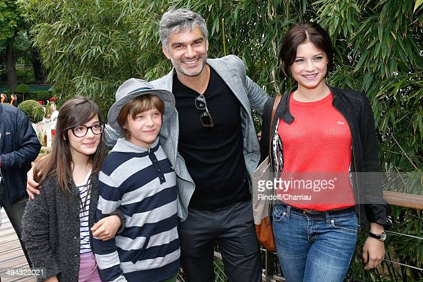 Actor Francois Vincentelli his companion actress Alice Dufour and his children Ange and Lucie attend the Roland Garros French Tennis Open 2014 Day 5...