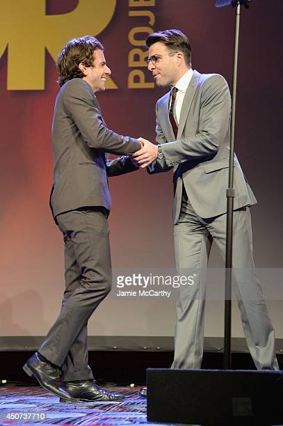 Actor Frank De Julio greets actor Zachary Quinto onstage at the Trevor Project's 2014 'TrevorLIVE NY' Event at the Marriott Marquis Hotel on June 16...