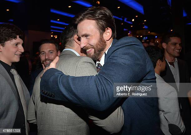 Actor Frank Grillo and Chris Evans attend the after party for Marvel's Captain America The Winter Soldier premiere at the El Capitan Theatre on March...
