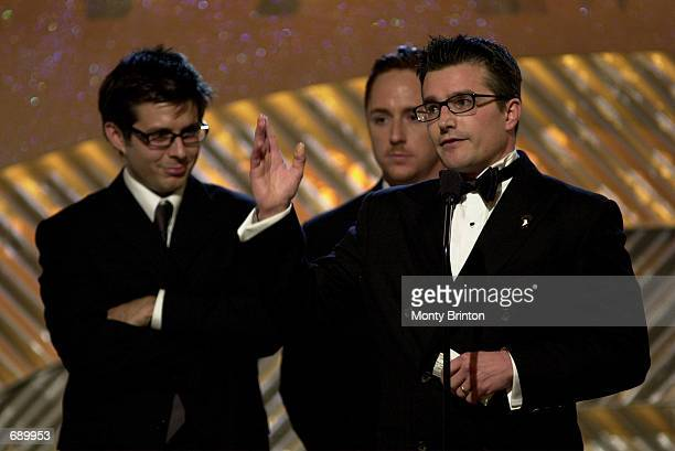 Actor Frank John Hughes accepts the award for Movie or Miniseries of the Year for HBOs Band Of Brothers as his fellow costars Rick Gomez and Scott...