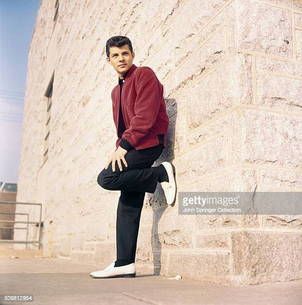 Actor Frankie Avalon Leaning on Building