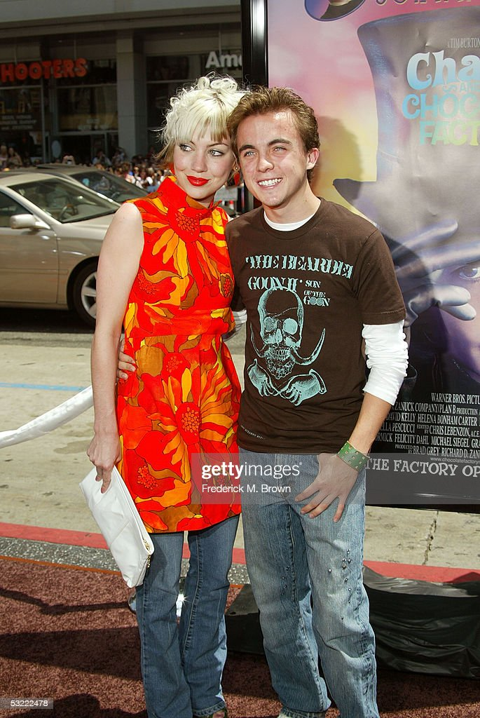 premiere of charlie and the chocolate factory photos and images  actor frankie muniz and guest arrive at the warner bros premiere of charlie and the