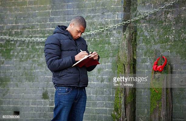 Actor Franz Drameh on the set of 100 Streets in Battersea on August 21 2014 in London England