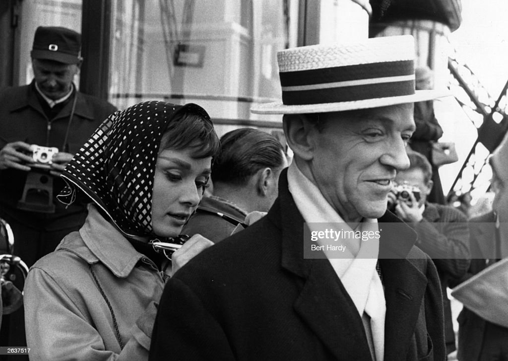 Actor Fred Astaire (1899-1987) on location in Paris with Audrey Hepburn (1929-1993) for the filming of the Paramount musical 'Funny Face'. Original Publication: Picture Post - 8540 - Audrey Dances With Astaire - pub. 1956