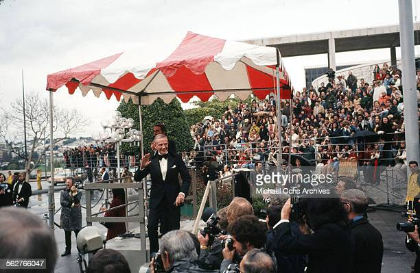 Actor Fred Astaire waves to the crowd as he arrives to the 47th Academy Awards at Dorothy Chandler Pavilion in Los AngelesCalifornia