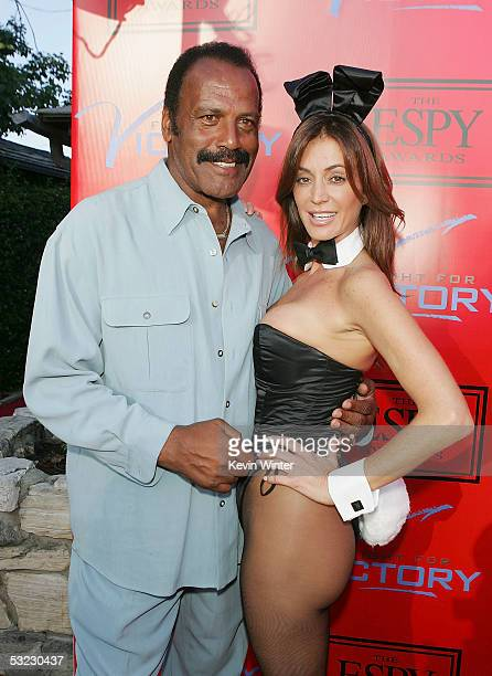 """Actor Fred Williamson and Playmate Ava Fabian pose at """"Fight for Victory"""", the 13th Annual Espy Pre-Party hosted by Andy Roddick at the Playboy..."""
