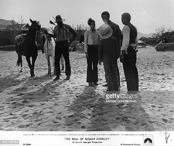 Actor Fred Williamson talks with a friends Denise Nicholas D'Urville Martin and Kirk Calloway in a scene from the movie The Soul Of Nigger Charley in...