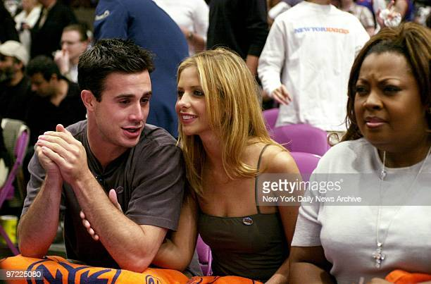 Actor Freddie Prinze Jr and actress Sarah Michelle Geller take in the action as the New York Knicks chilled the Miami Heat 9183 in Game 4 of the...