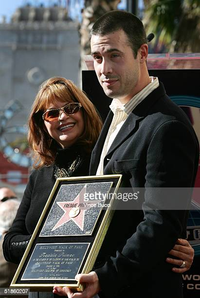 Actor Freddie Prinze Jr and his mother Cathy pose during a posthumous star dedication ceremony for actorcomedian Freddie Prinze on the Hollywood Walk...
