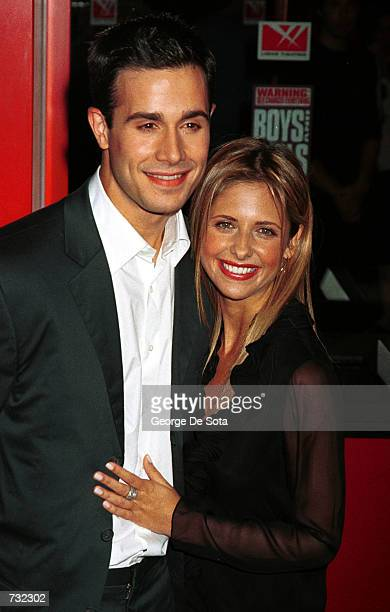 Actor Freddie Prinze Jr with his girlfriend Actress Sarah Michelle Gellar attend the world premiere of the Dimension Films release of 'Boys and...
