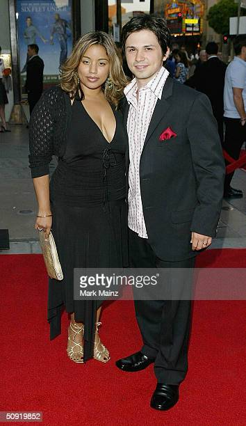 Actor Freddy Rodriguez and his wife attend the premiere of HBO's series Six Feet Under on June 2 2004 at the Graumans Chinese Theatre in Los Angeles...