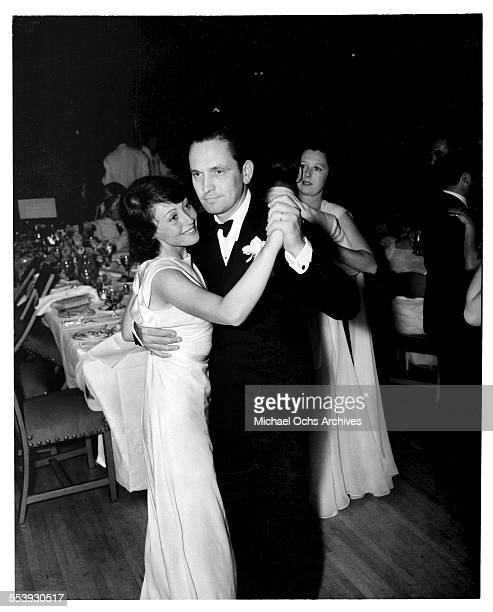 Actor Fredric March and actress Luise Rainer dance after the 10th Academy Awards in Los Angeles California