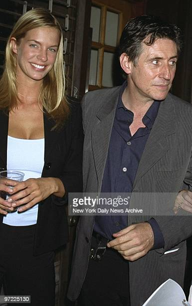 Actor Gabriel Byrne and friend model Natasha Wenger attend the Jill Freedman photo exhibit at Gallery 49 Byrne hosted the opening night and helped to...