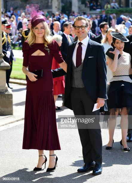 Actor Gabriel Macht and wife Jacinda Barrett arrive at St George's Chapel at Windsor Castle before the wedding of Prince Harry to Meghan Markle on...