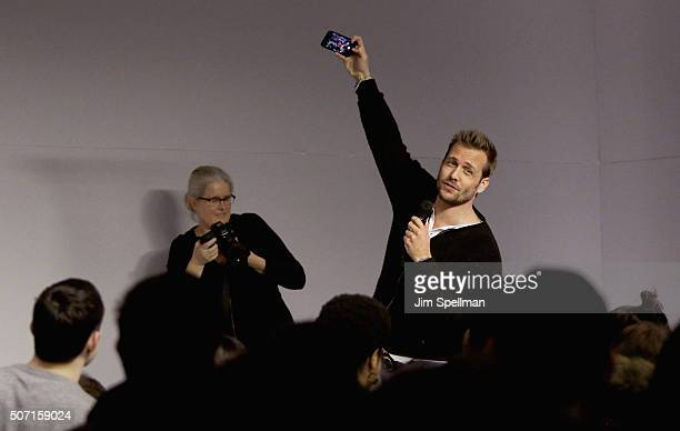 Actor Gabriel Macht takes a picture with the fans at the Meet the Actor Gabriel Macht Suits at Apple Store Soho on January 27 2016 in New York City