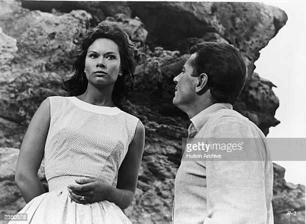 Actor Gabriele Ferzetti gazes at Lea Massari as she stares into the distance in a still from the film, 'L'Avventura,' directed by Michelangelo...