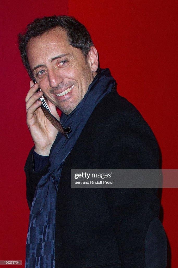 Actor Gad Elmaleh speaks on his mobile phone as he attends 'Le Capital' premiere at Gaumont Parnasse on November 12, 2012 in Paris, France.