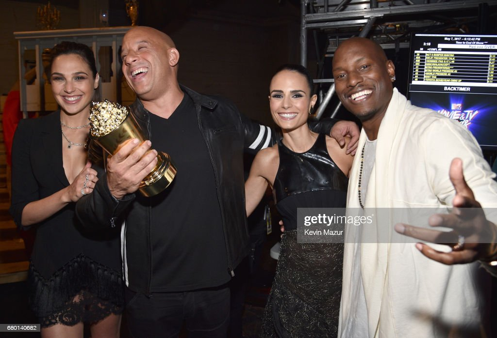 Actor Gal Gadot poses with actors Vin Diesel, Jordana Brewster, and Tyrese Gibson, who accepted the MTV Generation Award on behalf for 'The Fast and the Furious' franchise, backstage during the 2017 MTV Movie And TV Awards at The Shrine Auditorium on May 7, 2017 in Los Angeles, California.