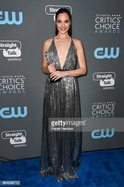 Actor Gal Gadot poses with the See Her Award in the press room during The 23rd Annual Critics' Choice Awards at Barker Hangar on January 11 2018 in...