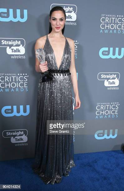 Actor Gal Gadot recipient of the Best Action Movie award for 'Wonder Woman' pose in the press room during The 23rd Annual Critics' Choice Awards at...
