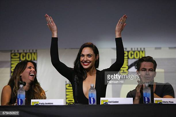 Actor Gal Gadot recognizes the crowd after the trailer for Wonder Woman is revealed during the third day of Comic Con in San Diego CA