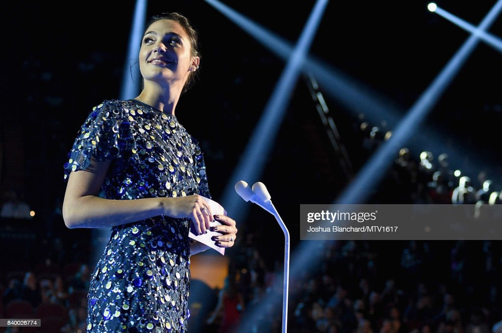 Actor Gal Gadot speaks on stage during the 2017 MTV Video Music Awards at The Forum on August 27, 2017 in Inglewood, California.