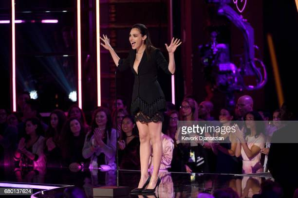 Actor Gal Gadot speaks onstage during the 2017 MTV Movie And TV Awards at The Shrine Auditorium on May 7 2017 in Los Angeles California