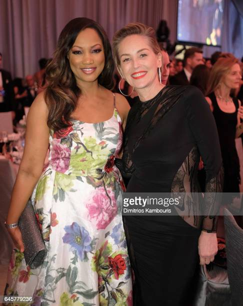 Actor Garcelle Beauvais and Actor Sharon Stone attend the 25th Annual Elton John AIDS Foundation's Academy Awards Viewing Party at The City of West...