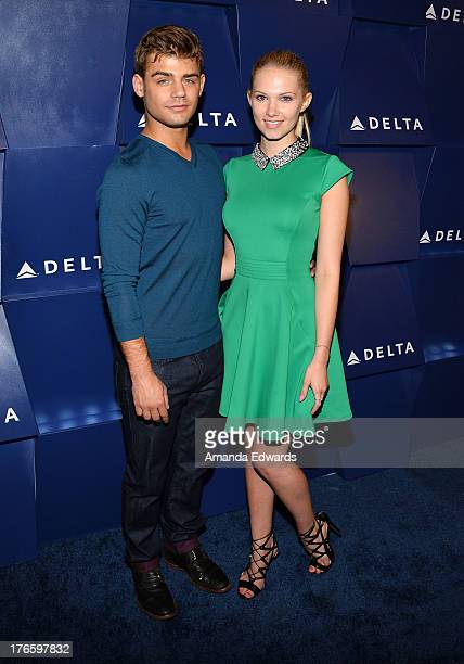 Actor Garrett Clayton and actress Claudia Lee arrive at the Delta Air Lines Summer Celebration at Beverly Grove Drive on August 15 2013 in Beverly...