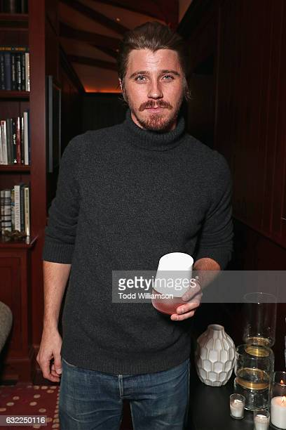 Actor Garrett Hedlund holds a Google Home at the Google Home Sundance dinner on January 20 2017 in Park City Utah