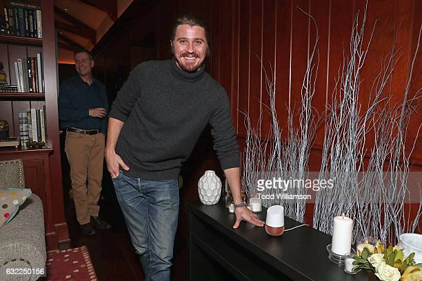 Actor Garrett Hedlund interacts with a Google Home at the Google Home Sundance dinner on January 20 2017 in Park City Utah