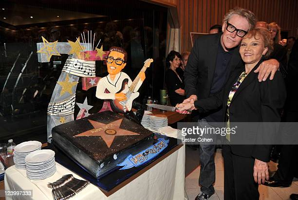 Actor Gary Busey and Maria Elena Holly attend a reception for the ceremony honoring Buddy Holly with the 2447th Star on the Hollywood Walk of Fame on...