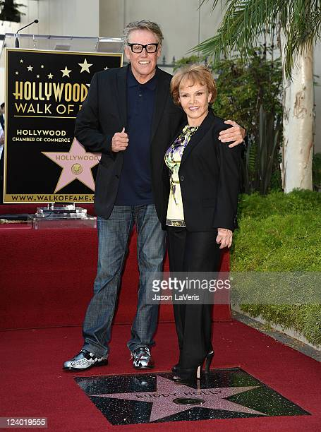 Actor Gary Busey and Maria Elena Holly attend Buddy Holly's induction into The Hollywood Walk of Fame on September 7 2011 in Hollywood California