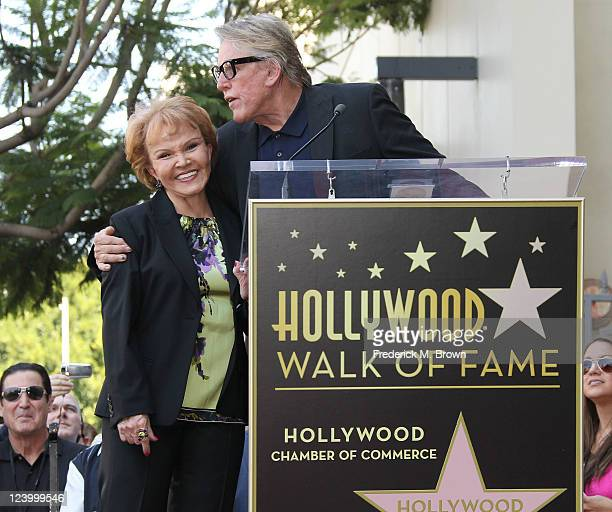 Actor Gary Busey and Maria Elena Holly pose for photographers during the ceremony for recording artist Buddy Holly's posthumous star on the Hollywood...
