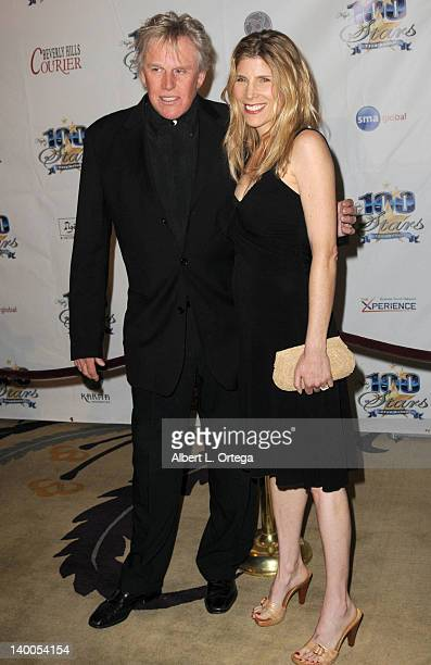 Actor Gary Busey and wife Judy Helkenberg arrive for Norby Walters' 22nd Annual Night Of 100 Stars Oscar Viewing Gala held at The Beverly Hills Hotel...